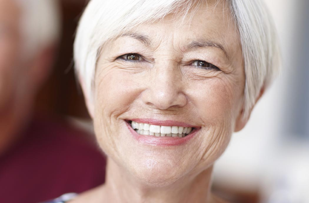 Senior woman dental patient with beautiful smile thanks to Dr. Keith Silverman